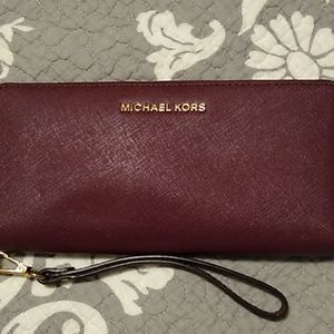 Michael Kors burgandy wallet.  NWT